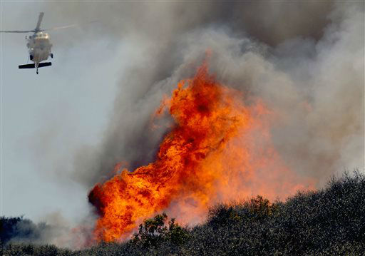 "<div class=""meta ""><span class=""caption-text "">A helicopter makes a water drop on a hotspot over a hill near Thousand Oaks, Calif. on Thursday, May 2, 2013. Authorities have ordered evacuations of a neighborhood and a university about 50 miles west of Los Angeles where a wildfire is raging close to subdivisions. The blaze on the fringes of Camarillo and Thousand Oaks broke out Thursday morning and was quickly spread by gusty Santa Ana winds. Evacuation orders include California State University, Channel Islands. (AP Photo/Nick Ut) (AP Photo/ Nick Ut)</span></div>"