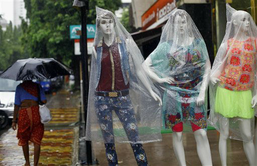 "<div class=""meta image-caption""><div class=""origin-logo origin-image ""><span></span></div><span class=""caption-text"">Mannequins are covered with plastic as it rains in Mumbai, India, Tuesday, June 18, 2013. The monsoon rains which usually hit India from June to September are crucial for farmers whose crops feed hundreds of millions of people. (AP Photo/Rafiq Maqbool) (AP Photo/ Rafiq Maqbool)</span></div>"