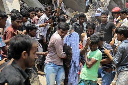 Rescue workers carry a victim&#39;s body after an eight-story building housing several garment factories collapsed in Savar, near Dhaka, Bangladesh, Wednesday, April 24, 2013. Dozens were killed and many more are feared trapped in the rubble. &#40;AP Photo&#47; A.M. Ahad&#41; <span class=meta>(AP Photo&#47; A.M. Ahad)</span>