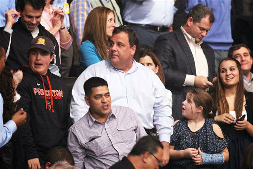 This image released by Starpix shows New Jersey Gov. Chris Christie, center, at the 12-12-12 The Concert for Sandy Relief at Madison Square Garden in New York on Wednesday, Dec. 12, 2012. Proceeds from the show will be distributed through the Robin Hood Foundation. &#40;AP Photo&#47;Starpix, Dave Allocca&#41; <span class=meta>(AP Photo&#47; Dave Allocca)</span>