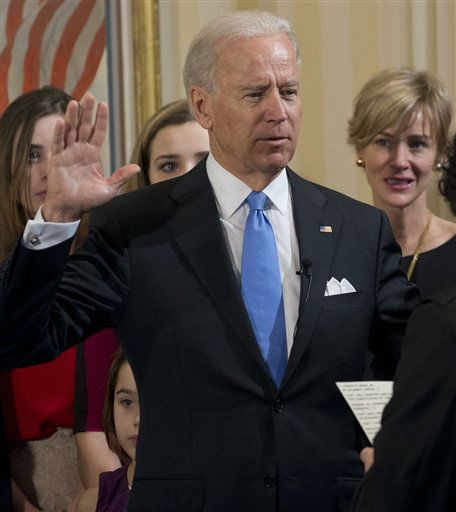 Vice President Joe Biden takes the oath of office during the 57th Presidential Inauguration official swearing-in ceremony at the Naval Observatory on Sunday, January 20,  2013 in Washington. The oath is administered by US Supreme Court Justice Sonia Sotomayor as family members look on.   &#40;AP Photo&#47;Saul Loeb, Pool&#41; <span class=meta>(AP Photo&#47; SAUL LOEB)</span>