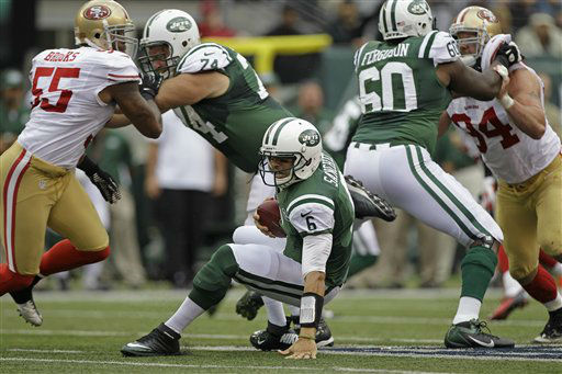 New York Jets quarterback Mark Sanchez &#40;6&#41; falls down as teammates  Nick Mangold &#40;74&#41; and  D&#39;Brickashaw Ferguson &#40;60&#41; block for him during the first half of an NFL football game against the San Francisco 49ers Sunday, Sept. 30, 2012, in East Rutherford, N.J. &#40;AP Photo&#47;Kathy Willens&#41; <span class=meta>(AP Photo&#47; Kathy Willens)</span>