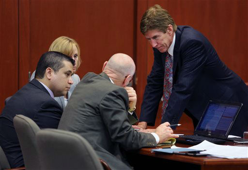 George Zimmerman, left,  confers with his defense counsel, Mark O&#39;Mara, Don West, and Lorna Truett, background, after working out the wording of instructions for a possible charge of manslaughter, on the 25th day of Zimmerman&#39;s  trial at the Seminole County Criminal Justice Center, in Sanford, Fla., Saturday, July  13, 2013. Zimmerman has been charged with the 2012 shooting death of Trayvon Martin.&#40;AP Photo&#47;Orlando Sentinel, Joe Burbank, Pool&#41; <span class=meta>(AP Photo&#47; Joe Burbank)</span>