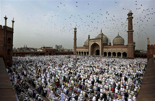 Indian Muslims take part in Eid al-Fitr prayers at Jama Masjid in New Delhi, India, Monday, Aug. 20, 2012. Muslims around the world are celebrating Eid al-Fitr, marking the end of Ramadan, the Muslim calendar's ninth and holiest month during which followers are required to abstain from food and drink from dawn to dusk. (AP Photo/Kevin Frayer)