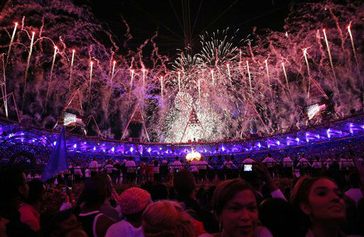 "<div class=""meta image-caption""><div class=""origin-logo origin-image ""><span></span></div><span class=""caption-text"">Fireworks illuminate the sky as the Olympic cauldron is lit during the Opening Ceremony at  the 2012 Summer Olympics, Saturday, July 28, 2012, in London. (AP Photo/Matt Dunham, Pool) (AP Photo/ Matt Dunham)</span></div>"