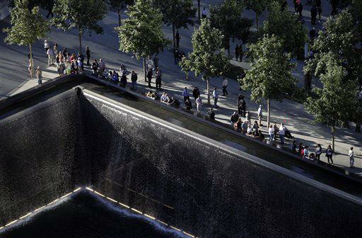Friends and relatives of the victims of the Sept. 11 terrorist attacks on the World Trade Center attend a ceremony marking the 11th anniversary of the attacks at the National September 11 Memorial at the World Trade Center site in New York, Tuesday, Sept. 11, 2012. &#40;AP Photo&#47;Mark Lennihan&#41; <span class=meta>(AP Photo&#47; Mark Lennihan)</span>