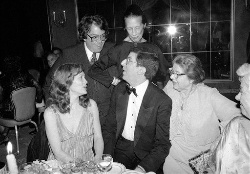 Marvin Hamlisch sits with Faye Dunaway, left, and Lilly Hamlisch, right, Marvin&#39;s mother, at a party in New York on April 13, 1980. Standing behind them are Allan Carr and Diane Vreeland. &#40;AP Photo&#47;Carlos Rene Perez&#41; <span class=meta>(AP Photo&#47; Carlos Rene Perez)</span>