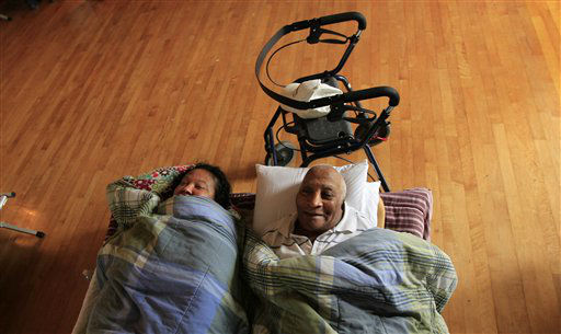 Teresa Ragas, left, and her husband Bertrand Ragas, of Port Sulphur, La., lie side-by-side in cots at an evacuation shelter in Belle Chasse, La., due to the impending landfall of Isaac, which is expected reach the region as a hurricane this evening, Tuesday, Aug. 28, 2012. The U.S. National Hurricane Center in Miami said Isaac became a Category 1 hurricane Tuesday with winds of 75 mph. &#40;AP Photo&#47;Gerald Herbert&#41; <span class=meta>(AP Photo&#47; Gerald Herbert)</span>