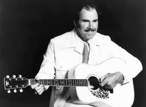 CORRECTS DATE OF DEATH TO JUNE 19 - FILE - This undated file photo shows country singer Slim Whitman. Whitman died Wednesday, June 19, 2013 of heart failure in Florida. He was 90. Whitman&#39;s career began in the late 1940s, and his tenor falsetto and ebony mustache and sideburns became global trademarks. They were also an inspiration for countless jokes thanks to the ubiquitous 1980s and 1990s TV commercials that pitched his records. &#40;AP Photo, file&#41; <span class=meta>(AP Photo&#47; Uncredited)</span>