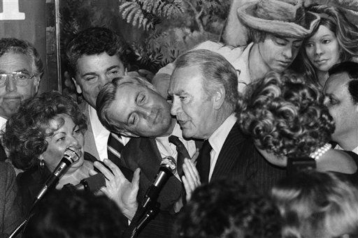 "<div class=""meta image-caption""><div class=""origin-logo origin-image ""><span></span></div><span class=""caption-text"">Vice President Walter Mondale peers around the shoulder of New York Gov. Hugh Carey as he spoke at the Hispanic women's conference in New York, Monday, Sept. 15, 1980. Mondale, who was behind Carey, craned his neck to see when he was pushed back. The use of a long lense makes it appear that Mondale is right behind Carey. (AP Photo/Perez) (AP Photo/ Perez)</span></div>"