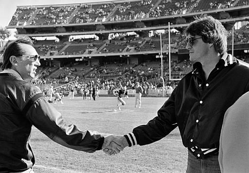 Oakland Raiders owner Al Davis, left, shakes hands with Raiders disabled quarterback Dan Pastorini before the game against the Dallas Cowboys Sunday afternoon at the Oakland Coliseum, December 7, 1980. Pastorini, was found with cocaine when stopped for traffic violation on November 27, will probably not face drug charges because of a procedural error, authorities said. Raiders fans are upset at Davis for his plans to move the Raiders to Los Angeles next year. &#40;AP Photo&#47;Paul Sakuma&#41; <span class=meta>(AP Photo&#47; PAUL SAKUMA)</span>