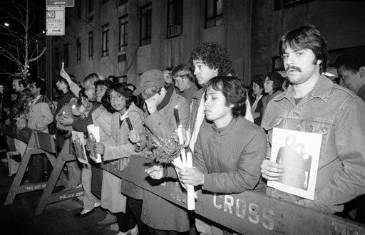 "<div class=""meta ""><span class=""caption-text "">Fans of the late John Lennon hold photos, candles and flowers outside the Dakota, the West Side apartment building in New York, Wednesday, Dec. 9, 1982, where John Lennon was shot to death two years ago. Lennon?s widow, Yoko Ono and her 7-year-old son, Sean, still live in the Dakota. Lennon was gunned down as he and Miss Ono arrived at the Dakota on Dec. 8, 1980. (AP Photo/David Bookstaver) (AP Photo/ David Bookstaver)</span></div>"