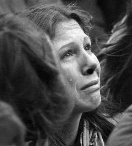 An unidentified woman weeps during the ten minute silent vigil for John Lennon held in front of Trinity Church in Boston, Sunday, Dec. 14, 1980. An estimated crowd of 2,000 people came to honor the former Beatle who was murdered in New York on Monday. &#40;AP Photo&#47;John Martell&#41; <span class=meta>(Photo&#47;Martell)</span>