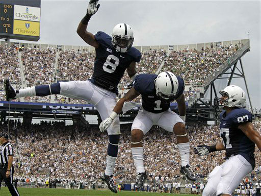 Penn State running back Bill Belton &#40;1&#41; celebrates with teammates wide receiver Allen Robinson &#40;8&#41; and tight end Kyle Carter &#40;87&#41; after rushing for the first touchdown of the new season during the first quarter of an NCAA college football game against Ohio at Beaver Stadium in State College, Pa., Saturday, Sept. 1, 2012. &#40;AP Photo&#47;Gene J. Puskar&#41; <span class=meta>(AP Photo&#47; Gene J. Puskar)</span>