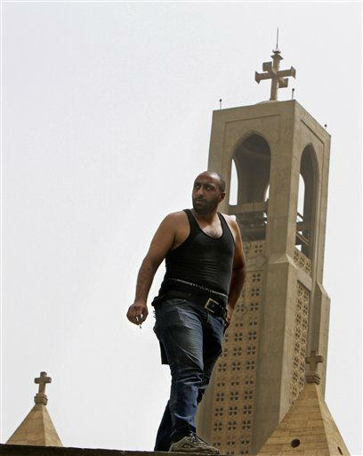 "<div class=""meta ""><span class=""caption-text "">An Egyptian Christian man stands on the wall of the Coptic cathedral in Cairo, Egypt, Monday, April 8, 2013. A senior Egyptian health ministry official says the death toll in clashes between Muslims and Christians in Cairo has risen to two. Dozens of people were injured. (AP Photo/Amr Nabil) (AP Photo/ Amr Nabil)</span></div>"
