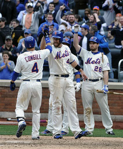 New York Mets&#39; John Buck &#40;44&#41; and Daniel Murphy &#40;28&#41; greet Collin Cowgill &#40;4&#41; at home plate after Cowgill hit a grand slam off San Diego Padres relief pitcher Brad Brach scoring Buck, Reuben Tejada and Jordany Valdespin in the seventh inning of an opening day baseball game at Citi Field on Monday, April 1, 2013 in New York. &#40;AP Photo&#47;Kathy Kmonicek&#41; <span class=meta>(AP Photo&#47; Kathy Kmonicek)</span>