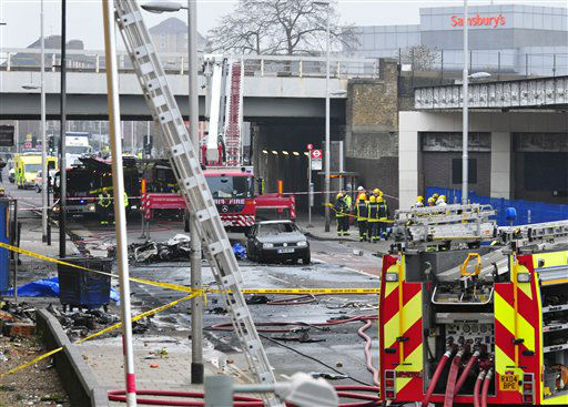 Debris lies on the ground after a helicopter crashed into a construction crane on top of St George&#39;s Wharf tower building, in London, Wednesday Jan. 16, 2013. Police say two people were killed when a helicopter crashed during rush hour in central London after apparently hitting a construction crane on top of a building. &#40;AP Photo&#47;Vince Pol&#41; <span class=meta>(AP Photo&#47; Vince Pol)</span>
