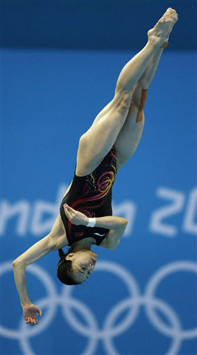 Gold medalist Wu Minxia from China competes during the women&#39;s 3-meter springboard diving final at the Aquatics Centre in the Olympic Park during the 2012 Summer Olympics in London, Sunday, Aug. 5, 2012. &#40;AP Photo&#47;Michael Sohn&#41; <span class=meta>(AP Photo&#47; Michael Sohn)</span>