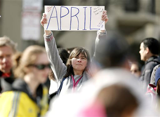 Justine Franco of Montpelier, Vt., holds up a sign near Copley Square in Boston looking for her missing friend, April, who was running in her first Boston Marathon Monday, April 15, 2013. Two bombs exploded near the finish line of the marathon on Monday, killing at least two people and injuring at least 23 others. &#40;AP Photo&#47;Winslow Townson&#41; <span class=meta>(AP Photo&#47; Winslow Townson)</span>