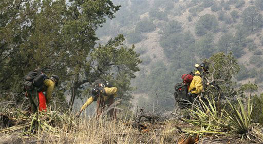 "<div class=""meta ""><span class=""caption-text "">FILE - In this June 2, 2012 file photo, firefighters from the Granite Mountain Hotshots of Prescott, Ariz. cut a fire line along a mountain ridge in the Gila National Forest outside Mogollon, N.M. On Sunday, June 30, 2013, a fast-moving wildfire killed 19 firefighters from the Prescott-based group after the blaze raced through the central Arizona town of Yarnell, about 85 miles northwest of Phoenix. (AP Photo/U.S. Forest Service, Tara Ross) (AP Photo/ Tara Ross)</span></div>"