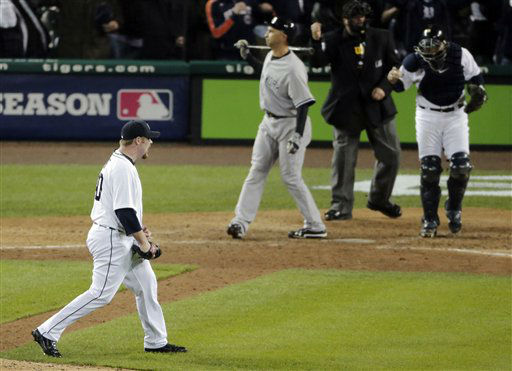 Detroit Tigers&#39; Phil Coke reacts after striking out New York Yankees&#39; Raul Ibanez for the final out during Game 3 of the American League championship series Tuesday, Oct. 16, 2012, in Detroit. &#40;AP Photo&#47;Charlie Riedel&#41; <span class=meta>(AP Photo&#47; Charlie Riedel)</span>