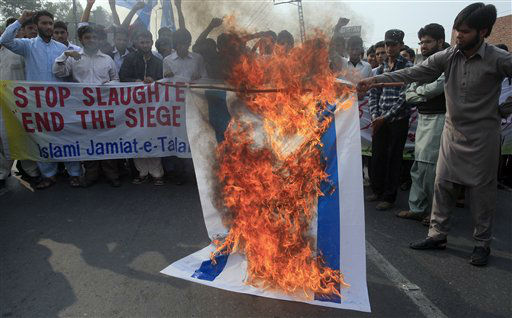 Supporters of a Pakistan religious student group Islami Jamiat Talaba burn a representative of Israeli flag during a demonstration against the Israeli offensive in Gaza, Saturday, Nov. 17, 2012 in Lahore, Pakistan. &#40;AP Photo&#47;K.M. Chaudary&#41; <span class=meta>(AP Photo&#47; K.M. Chaudary)</span>