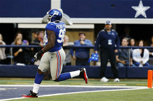 New York Giants defensive end Jason Pierre-Paul &#40;90&#41; runs in for a touchdown after intercepting a pass from Dallas Cowboys quarterback Tony Romo during the first half of an NFL football game, Sunday, Oct. 28, 2012, in Arlington, Texas. &#40;AP Photo&#47;Sharon Ellman&#41; <span class=meta>(AP Photo&#47; Sharon Ellman)</span>
