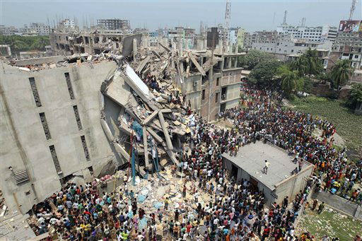 "<div class=""meta image-caption""><div class=""origin-logo origin-image ""><span></span></div><span class=""caption-text"">People and rescuers gather after an eight-story building housing several garment factories collapsed in Savar, near Dhaka, Bangladesh, Wednesday, April 24, 2013. Dozens were killed and many more are feared trapped in the rubble. (AP Photo/ A.M. Ahad) (AP Photo/ A.M. Ahad)</span></div>"
