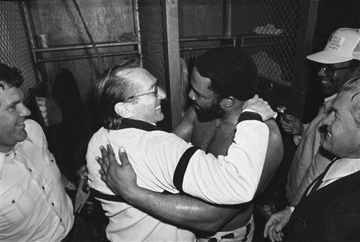 Oakland Raiders owner Al Davis, left, hugs Raiders Kenny King in the locker room on Jan. 11, 1981 in San Diego, after the Raiders beat the San Diego Chargers 34-27 to win the AFC championship and a right to the Super bowl in New Orleans. &#40;AP Photo&#41; <span class=meta>(AP Photo&#47; Anonymous)</span>