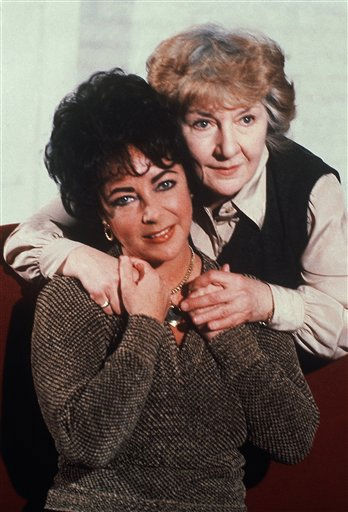 Actress Elizabeth Taylor being hugged by Maureen Stapleton, during rehearsal in New York on Feb. 3, 1981 for the new Broadway play &#34; The Little Foxes.&#34;  Taylor, who has never appeared on Broadway, will open the show in April. &#40;AP Photo&#47;Marty Lederhandler&#41; <span class=meta>(AP Photo&#47; Marty Lederhandler)</span>