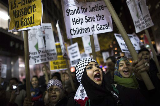 "<div class=""meta ""><span class=""caption-text "">Rabab Idly, 18, chants during an anti-war protest regarding the expanding hostilities between Israel and Hamas in the Gaza Strip, Monday, Nov. 19, 2012, on 42nd Street in New York. Israel and Gaza's Hamas rulers traded fire and tough cease-fire proposals Monday, and threatened to escalate their border conflict if diplomacy fails. No deal appeared near. (AP Photo/John Minchillo)</span></div>"