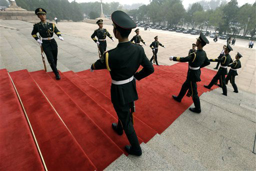 Chinese soldiers prepare for the arrival of German Chancellor Angela Merkel outside the Great Hall of the People in Beijing Thursday, Aug. 30, 2012. &#40;AP Photo&#47;Ng Han Guan&#41; <span class=meta>(AP Photo&#47; Ng Han Guan)</span>