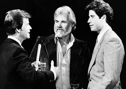 &#34; American Bandstand: host Dick Clark, left, reminisces with Kenny Rogers, center, and John Travolta about their early music careers during taping recently of &#34; American Bandstand&#39;s 30th Anniversary Special.&#34; October 27, 1981. The ABC television special will be broadcast Oct. 30. Rogers and Travolta are among the many stars gathering to help Clark celebrate his show&#39;s becoming one of the longest running variety shows on television. &#40;AP Photo&#47;ABC-TV&#41; <span class=meta>(AP Photo&#47; Anonymous)</span>