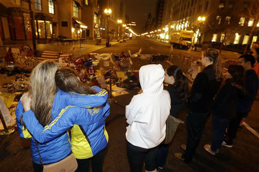 "<div class=""meta ""><span class=""caption-text "">Lisa Mara, 27, left, and her best friend Heather Buda, 26, embrace each other while paying respects at a makeshift memorial on Boylston Street near the finish line of the Boston Marathon, Friday, April 19, 2013, in Boston. Marathon bombing suspect Dzhokhar Tsarnaev was captured in Watertown, Mass. The 19-year-old college student wanted in the bombings was taken into custody Friday evening after a manhunt that left the city virtually paralyzed and his older brother and accomplice dead.  (AP Photo/Julio Cortez) (AP Photo/ Julio Cortez)</span></div>"