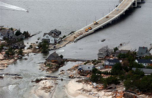The view of storm damage over the Atlantic Coast in Mantoloking, N.J.,  Wednesday, Oct. 31, 2012, from a helicopter traveling behind the helicopter carrying President Obama and New Jersey Gov. Chris Christie, as they viewed storm damage from superstorm Sandy.   &#40;AP Photo&#47;Doug Mills, Pool&#41; <span class=meta>(AP Photo&#47; Doug Mills)</span>