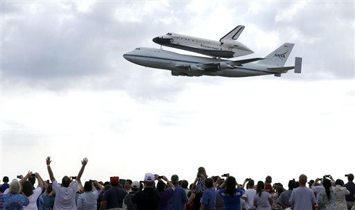 "<div class=""meta image-caption""><div class=""origin-logo origin-image ""><span></span></div><span class=""caption-text"">Space shuttle Endeavour flies over Ellington Field in Houston atop the shuttle aircraft carrier Wednesday, Sept. 19, 2012. Endeavour is making a final trek across the country to the California Science Center in Los Angeles, where it will be permanently displayed. (AP Photo/David J. Phillip) (AP Photo/ David J. Phillip)</span></div>"