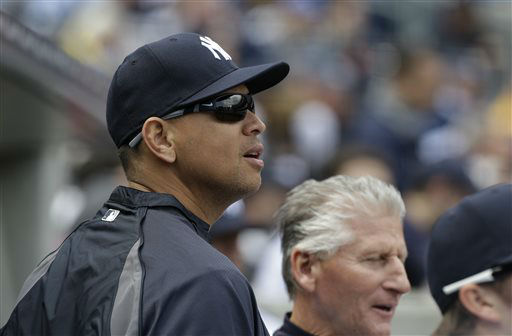 New York Yankees&#39; Alex Rodriguez, left, and first base coach Mick Kelleher watch the New York Yankees play the Boston Red Sox at an Opening Day baseball game at Yankee Stadium in New York, Monday, April 1, 2013.  &#40;AP Photo&#47;Kathy Willens&#41; <span class=meta>(AP Photo&#47; Kathy Willens)</span>