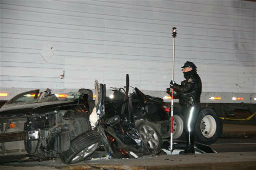 "<div class=""meta image-caption""><div class=""origin-logo origin-image ""><span></span></div><span class=""caption-text"">In this photo provided by VosIzNeias.com, a police officer works at the scene of a car accident that took the lives of an expectant couple in Brooklyn's Williamsburg neighborhood, Sunday, March 3, 2013, in New York. The young couple who had taken a car service to a hospital for the birth of their first child were killed en route by the driver of a BMW who fled the scene, but the couple's baby boy survived, born prematurely, authorities and a neighbor said. Their infant son was in serious condition at a hospital, and the driver of car that was hit was in stable condition. (AP Photo/VosIzNeias.com, Shimon Gifter) (AP Photo/ Shimon Gifter)</span></div>"