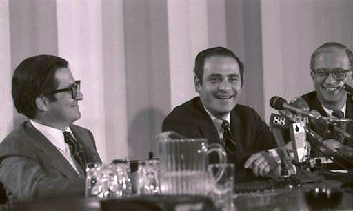 FILE - This July 1, 1971 file photo shows New York Times president and publisher Arthur Ochs Sulzberger, center, smiling at a news conference in New York, regarding the supreme court ruling permitting the Times to continue it&#39;s series of articles based on secret pentagon papers about U.S. involvement in Vietnam. Others in photo are unidentified. Sulzberger has died at age 86.  The newspaper reports that his family says Sulzberger died Saturday, Sept. 29, 2012, at his home in Southampton, N.Y., after a long illness. He had retired in 1992 after three decades at the paper&#39;s helm and was succeeded by his son, Arthur Jr. &#40;AP Photo&#47;Marty Lederhandler, File&#41; <span class=meta>(AP Photo&#47; Marty Lederhandler)</span>
