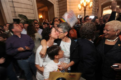 Sue Rochman, left, and Robin Romdalvik kiss, reacting to the U.S. Supreme Court&#39;s ruling on gay marriage in California, at San Francisco&#39;s City Hall on Wednesday, June 26, 2013. The couple is accompanied by their son Maddox Rochman-Romdalvik.  The justices issued two 5-4 rulings in their final session of the term. One decision wiped away part of a federal anti-gay marriage law that has kept legally married same-sex couples from receiving tax, health and pension benefits. The other was a technical legal ruling that said nothing at all about same-sex marriage, but left in place a trial court&#39;s declaration that California&#39;s Proposition 8 is unconstitutional.  &#40;AP Photo&#47;Noah Berger&#41; <span class=meta>(AP Photo&#47; Noah Berger)</span>