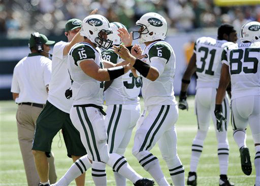 New York Jets quarterbacks Tim Tebow and  Mark Sanchez celebrate during the first half of an NFL football game between the New York Jets and the Buffalo Bills at MetLife Stadium Sunday, Sept. 9, 2012, in East Rutherford, N.J. &#40;AP Photo&#47;Bill Kostroun&#41; <span class=meta>(AP Photo&#47; Bill Kostroun)</span>