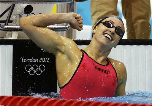 United States&#39; Rebecca Soni celebrates winning gold and setting a new world record in the women&#39;s 200-meter breaststroke swimming final at the Aquatics Centre in the Olympic Park during the 2012 Summer Olympics in London, Thursday, Aug. 2, 2012. Soni set a new world record with a time of 2:19.59. &#40;AP Photo&#47;Michael Sohn&#41; <span class=meta>(AP Photo&#47; Michael Sohn)</span>