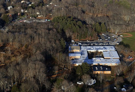"<div class=""meta image-caption""><div class=""origin-logo origin-image ""><span></span></div><span class=""caption-text"">This aerial photo shows Sandy Hook Elementary School in Newtown, Conn., right, where authorities say a gunman opened fire inside the school in a shooting that left 27 people dead, including 18 children, Friday, Dec. 14, 2012. (AP Photo/Julio Cortez) (AP Photo/ Julio Cortez)</span></div>"