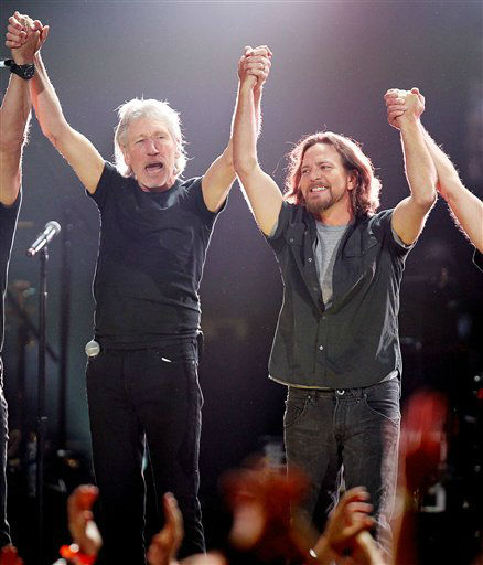 This image released by Starpix shows Roger Waters, left, and Eddie Vedder at the 12-12-12 The Concert for Sandy Relief at Madison Square Garden in New York on Wednesday, Dec. 12, 2012. Proceeds from the show will be distributed through the Robin Hood Foundation. &#40;AP Photo&#47;Starpix, Dave Allocca&#41; <span class=meta>(AP Photo&#47; Dave Allocca)</span>