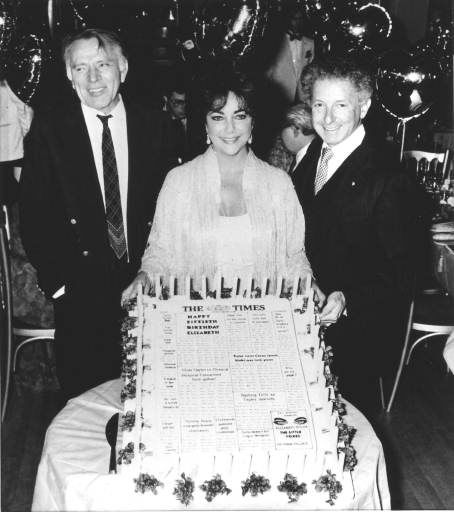 Actress Elizabeth Taylor&#39;s celebrates her 50th birthday with an enormous cake at Legends, a London nightclub,  Sunday, Feb. 28, 1982.  At left is actor Richard Burton and at right is theatrical producer Zev Bufman, who hosted the party . &#40;AP Photo&#41; <span class=meta>(AP Photo&#47; XMH XBE XCO)</span>