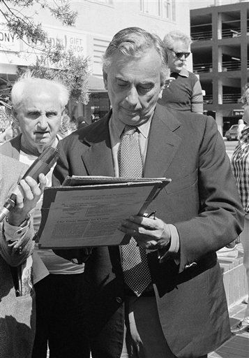 Democratic senatorial candidate Gore Vidal signs a gun control initiative petition while campaigning in Santa Monica, California, on Saturday, afternoon, on April 17, 1982. Vidal was holding a handshaking meet the people campaign when asked to sign the petition. &#40;AP Photo&#47;Susie Hanover&#41; <span class=meta>(AP Photo&#47; Susie Hanover)</span>