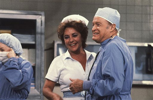 Actress Elizabeth Taylor in a nurse&#39;s uniform with Bob Hope on Bob Hope TV special in sketch ?Not-So-General Hospital? on Sept. 13, 1982. &#40;AP Photo&#47; Reed Saxon&#41; <span class=meta>(AP Photo&#47; Reed  Saxon)</span>