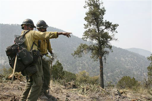 FILE - In this June 2, 2012 file photo, firefighters from the Granite Mountain Hotshots of Prescott, Ariz. cut a fire line along a mountain ridge in the Gila National Forest outside Mogollon, N.M. On Sunday, June 30, 2013, a fast-moving wildfire killed 19 firefighters from the Prescott-based group after the blaze raced through the central Arizona town of Yarnell, about 85 miles northwest of Phoenix. &#40;AP Photo&#47;U.S. Forest Service, Tara Ross&#41; <span class=meta>(AP Photo&#47; Tara Ross)</span>
