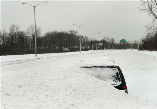 "<div class=""meta image-caption""><div class=""origin-logo origin-image ""><span></span></div><span class=""caption-text"">An abandoned vehicle is covered in snow along an empty Interstate 91 southbound after a winter storm in East Windsor, Conn. on Saturday, Feb. 9, 2013. Gov. Dannel P. Malloy has ordered all roads in Connecticut closed until further notice except for emergency response and recovery vehicles with the capacity to maneuver in heavy snow. (AP Photo/Jessica Hill) (AP Photo/ Jessica Hill)</span></div>"