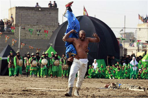 "<div class=""meta image-caption""><div class=""origin-logo origin-image ""><span></span></div><span class=""caption-text"">Shiite Muslims re-enact the seventh century battle of Karbala during the climax of the festival of Ashoura in the Shiite neighborhood of Sadr City in Baghdad, Iraq, Sunday, Nov. 25, 2012. The festival of Ashoura commemorates the martyrdom of Imam Hussein, The grandson of Prophet Muhammad at the Battle of Karbala, Iraq, in the year 680 A.D. (AP Photo/Hadi Mizban) (AP Photo/ Hadi Mizban)</span></div>"